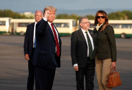U.S. President Donald Trump pumps his fist as he and first lady Melania Trump arrive in Glasgow, Scotland, Britain July 13, 2018. REUTERS/Kevin Lamarque