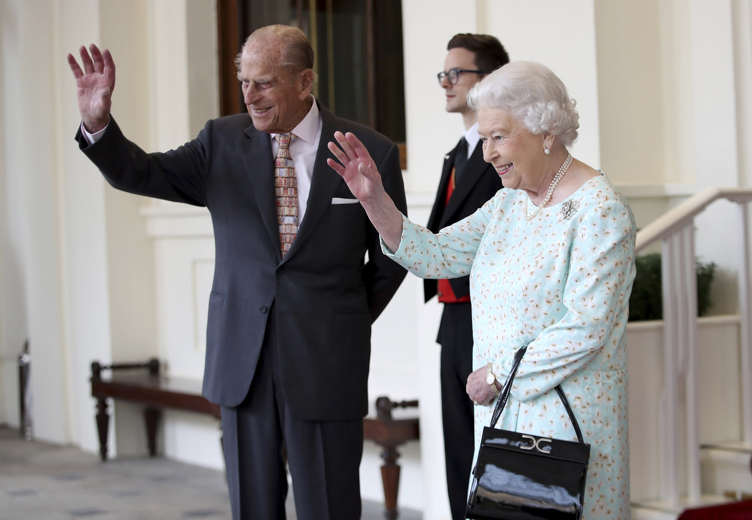 Britain's Queen Elizabeth II and Prince Philip wave as Spain's King Felipe and Queen Letizia leave Buckingham Palace, London, Friday July 14, 2017, after their three day State visit. (Chris Jackson/Pool via AP)