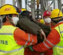 China mine rescue: Nine miners brought to surface, say state media