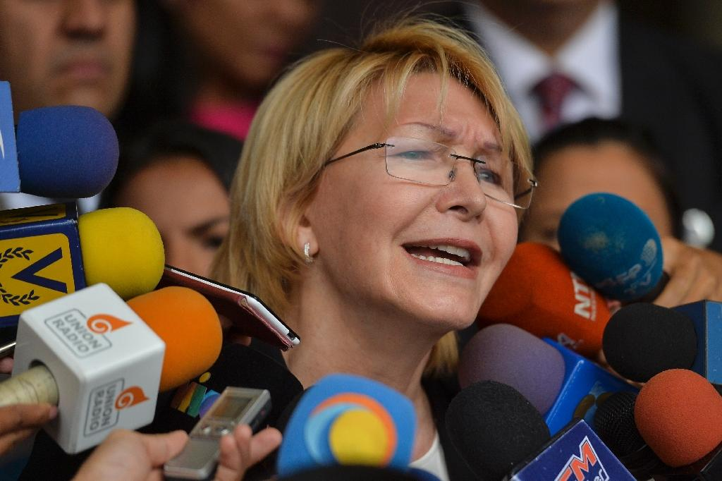 Venezuela's attorney general Luisa Ortega is the highest public official to break ranks with President Nicolas Maduro over the country's deadly political crisis (AFP Photo/LUIS ROBAYO)
