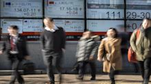 Asian stocks close mixed; investors focus on political developments