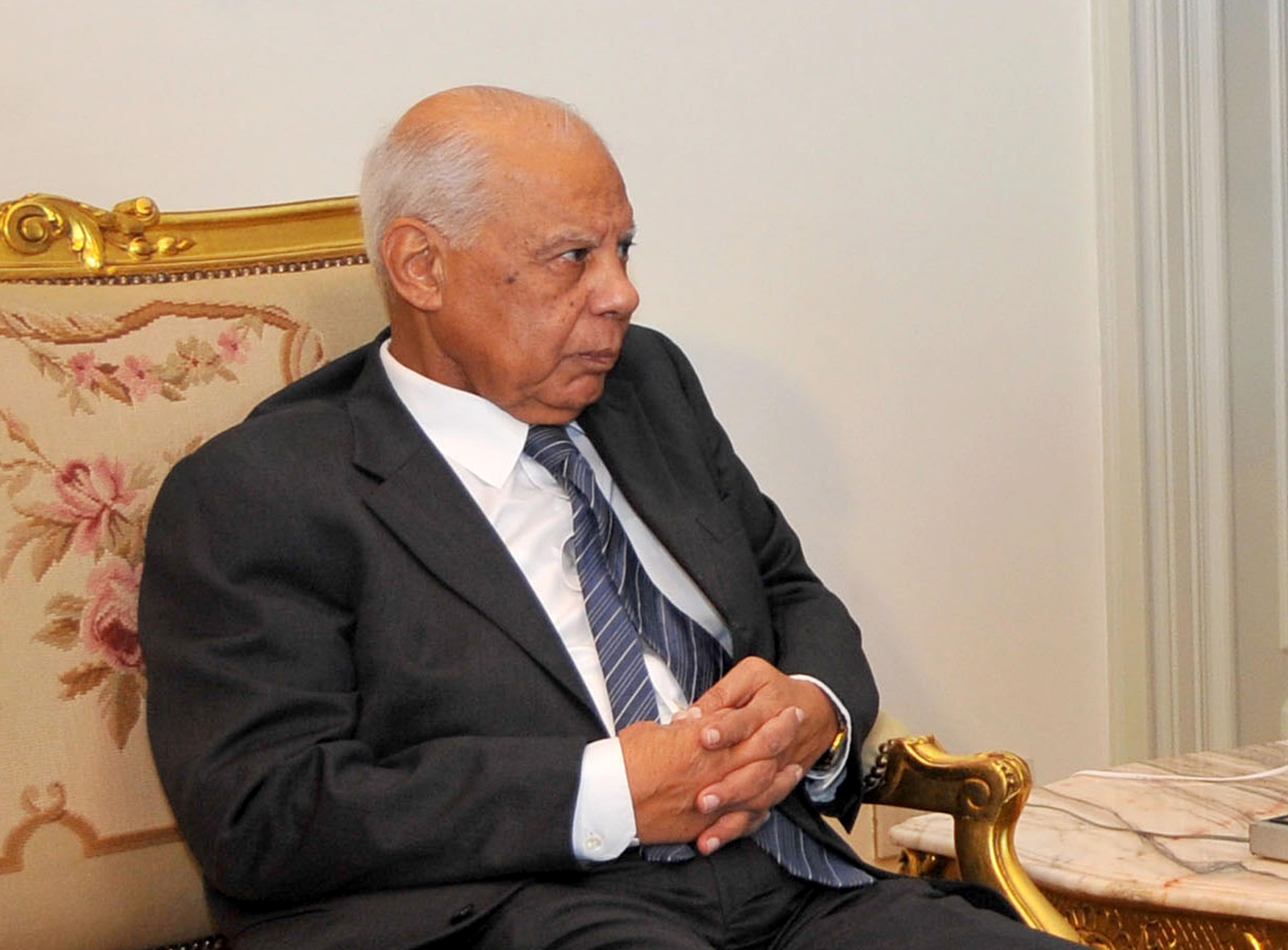 FILE - In this Tuesday, July 9, 2013 file photo released by the Egyptian Presidency, Hazem el-Beblawi meets with interim President Adly Mansour, unseen, in Cairo, Egypt. Egypt's interim president on Tuesday swore in the first Cabinet since the military ousted the Islamist president, giving members of the country's liberal movements key positions. The Cabinet includes three women. The new government is led by Prime Minister Hazem el-Beblawi, an economist. Army chief Gen. Abdel-Fattah el-Sissi, who ousted Mohammed Morsi on July 3, retains his post as defense minister and also took the position of first deputy prime minister, an additional title given to defense ministers in the past.(AP Photo/Egyptian Presidency, File)