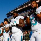 Dolphins will respond to President Trump's tweets with linked arms, report says
