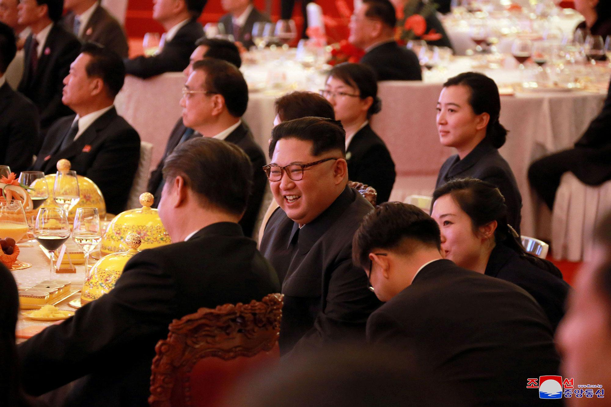 <p>North Korean leader Kim Jong Un smiles during a banquet in Beijing, as he paid an unofficial visit to China, in this undated photo released by North Korea's Korean Central News Agency (KCNA) in Pyongyang, March 28, 2018. (Photo: KCNA/via Reuters) </p>