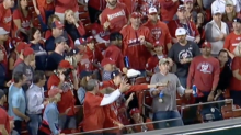 Watch: Baseball fan takes home run to the stomach rather than drop his beers
