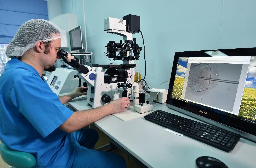Embryologist Viktor Nagornyi working in the Kiev-based Nadiya private fertility clinic (AFP Photo/Genya SAVILOV)