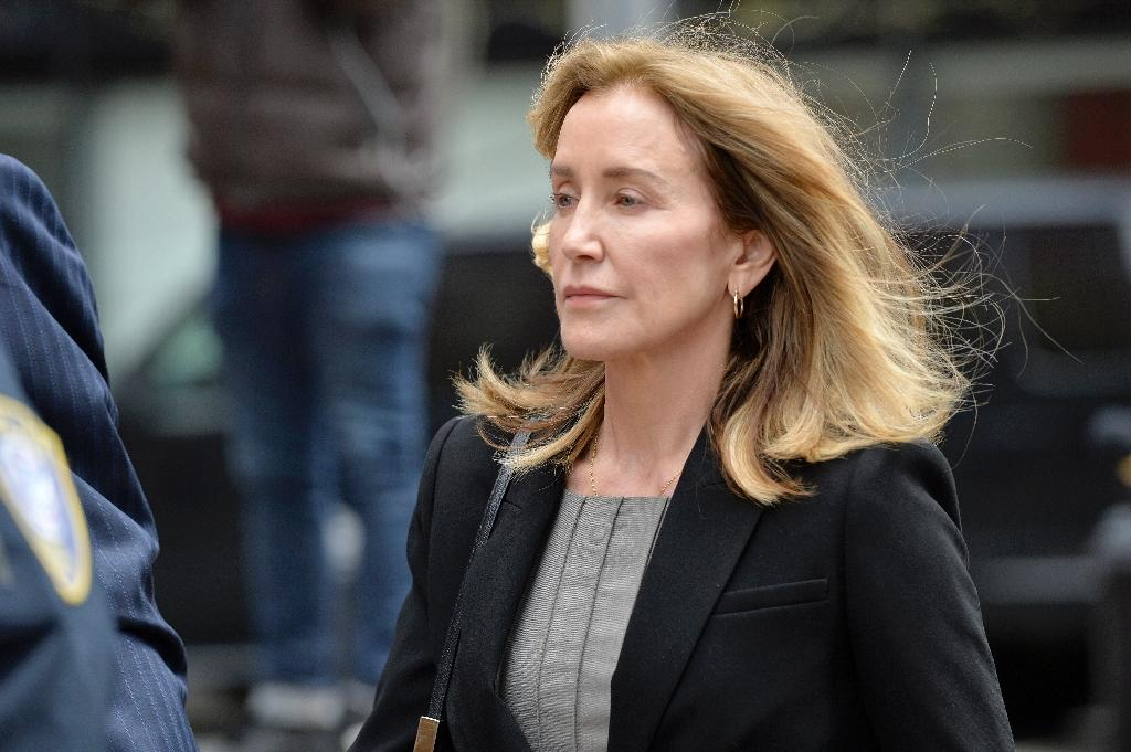 Actress Felicity Huffman arrives at court in Boston