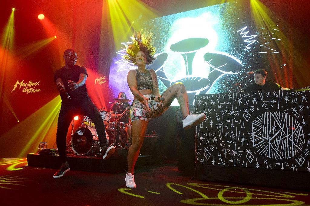 From L: Kalaf Angelo, Karla Rodrigues and Joao Barbosa from Buraka Som Sistema perform on July 6, 2015 at the Montreux Jazz lab stage (AFP Photo/Fabrice Coffrini)