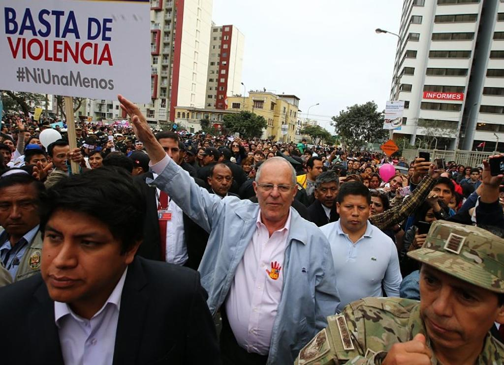 "President Pedro Pablo Kuczynski joined thousands of demonstrators in Lima marching in support of the ""Ni una menos"" (Not One Less) movement (AFP Photo/)"