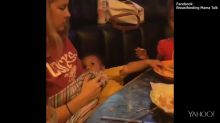 Viral video shows a baby feeding his mum chips while being breastfed