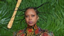 Erykah Badu Joins the Graffiti Trend and Draws on Her Clean, White Margiela Boots