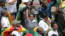 Zimbabwe protesters begin marching towards Mugabe residence