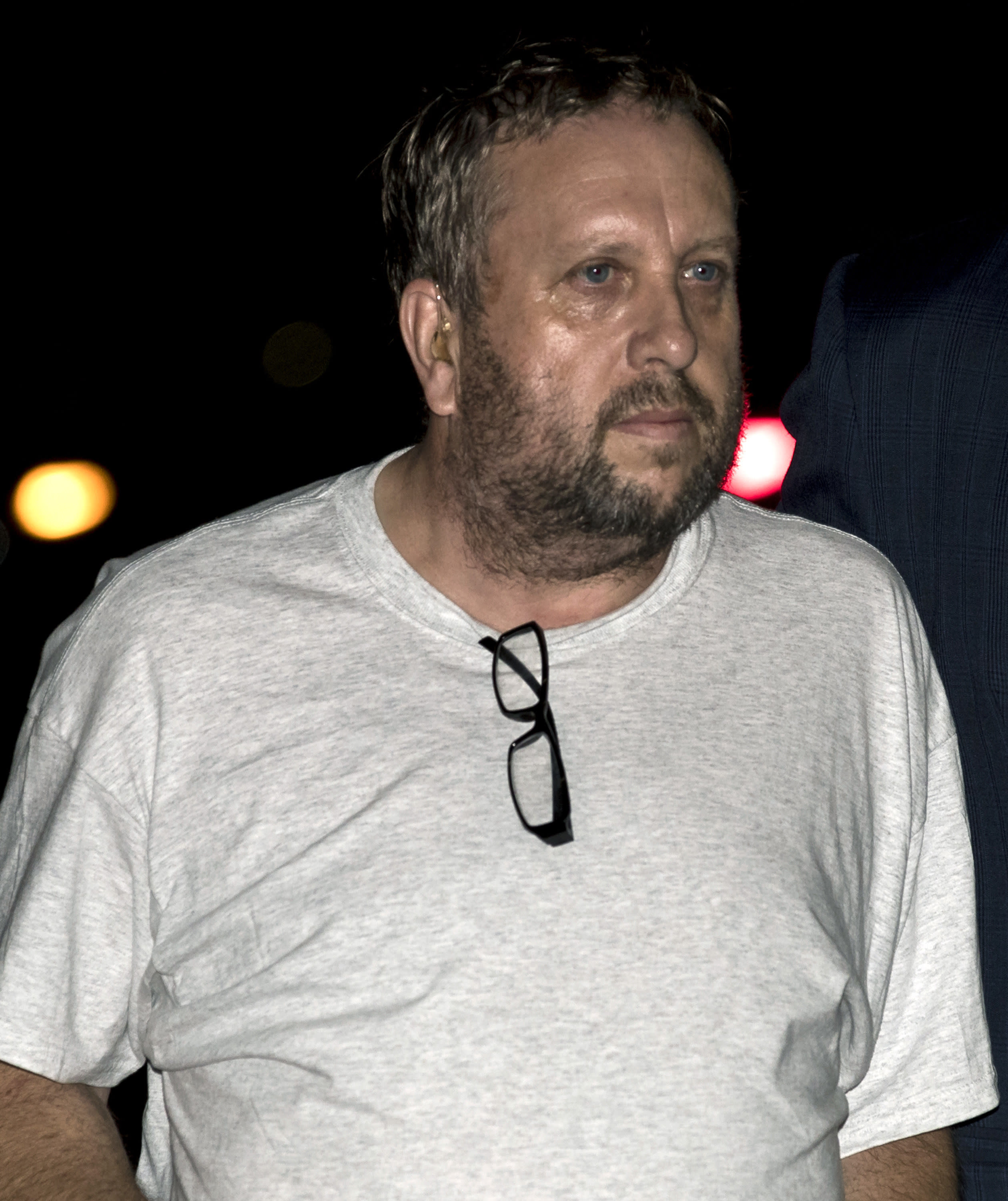 FILE - In this Aug. 18, 2017 file photo, Andrew Warren arrives at a police station as he is escorted by Chicago police, in Chicago. Andrew Warren, a British man accused in the fatal stabbing of a hair stylist in Chicago, agreed Monday, July 22, 2019 to plead guilty and testify against his co-defendant, Wyndham Lathem, in the killing of a former Northwestern University professor in exchange for a 45-year-prison sentence. (AP Photo/Jim Young, Pool, File)
