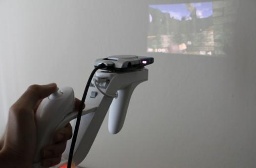Laser projector stuck to Wii Remote for faux 360-degree immersion