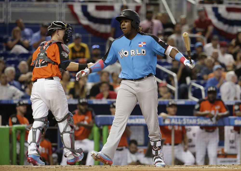 World Team's Vladimir Guerrero Jr., front right, of the Toronto Blue Jays, strikes out during the second inning of the All-Star Futures baseball game against the U.S. Team, Sunday, July 9, 2017, in Miami.