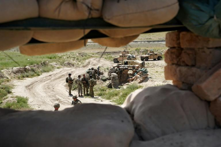 US troops are seen in June 2019 through a firing position at an Afghan army checkpoint in Wardak province west of Kabul -- US President Donald Trump is looking to reduce the number of US forces in Afghanistan