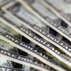 Dollar falls on U.S. tax reform caution