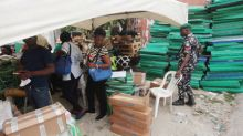 After false start, Nigerians focus on economy in tight presidential vote