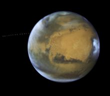 Moon Photobombs Mars In Hubble Images For NASA