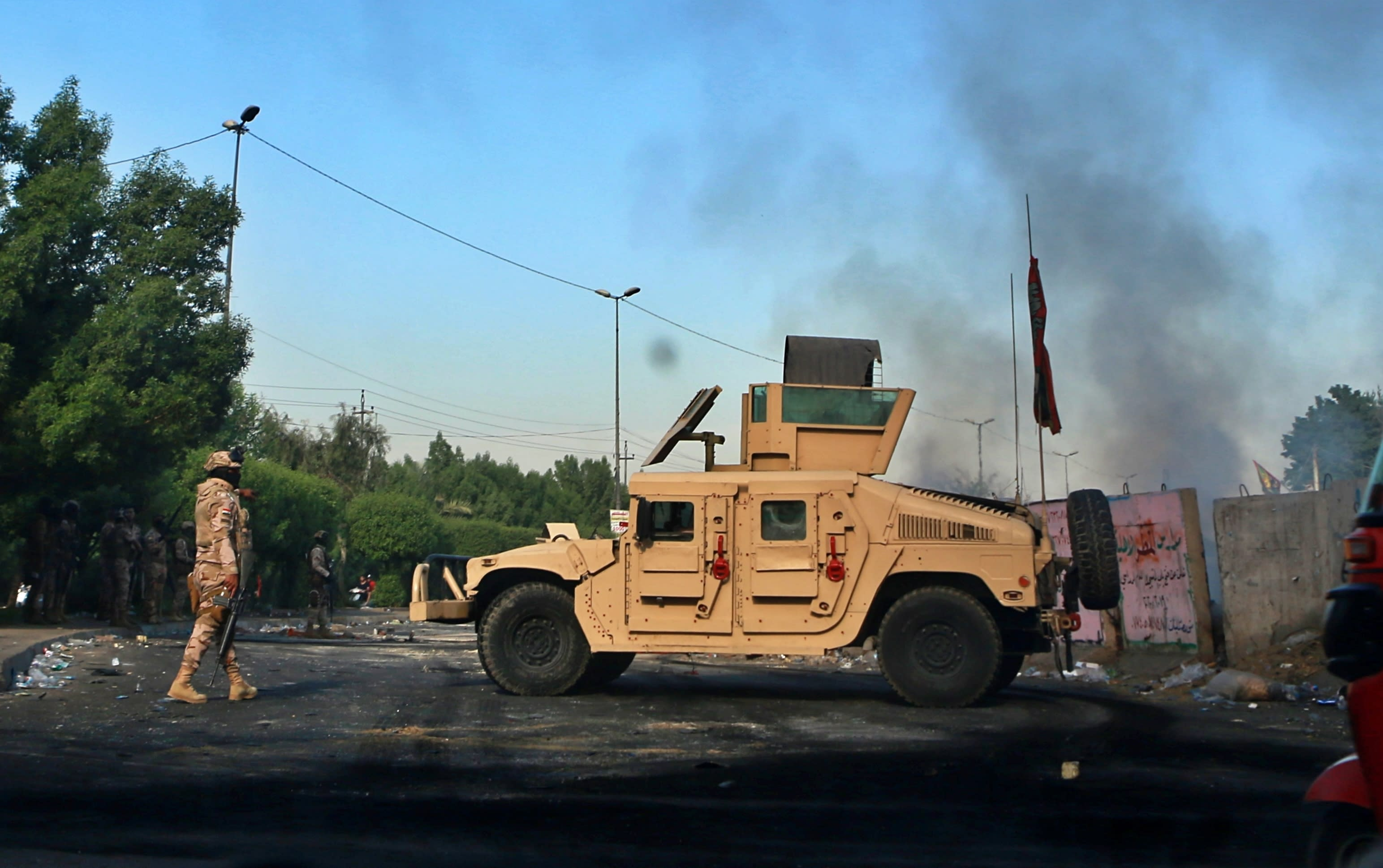 Iraqi Army troops deploy at a site of protests in Baghdad, Iraq, Sunday, Oct. 6, 2019. The spontaneous protests which started Tuesday in Baghdad and southern cities were sparked by endemic corruption and lack of jobs. Security forces responded with a harsh crackdown, with dozens killed. (AP Photo/Khalid Mohammed)