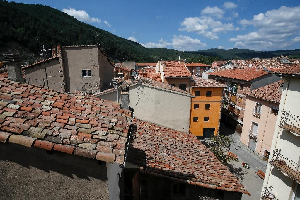 The decrepit two-room flat where Iman Abdelbaki Es Natty lived has a view of the tree-covered Pyrenees and the red roofs of the quaint Catalonian town of Ripoll (AFP Photo/PAU BARRENA)
