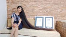 Vom Friseurtrauma ins Guinness-Buch: Inderin verteidigt Teenager-Haarrekord