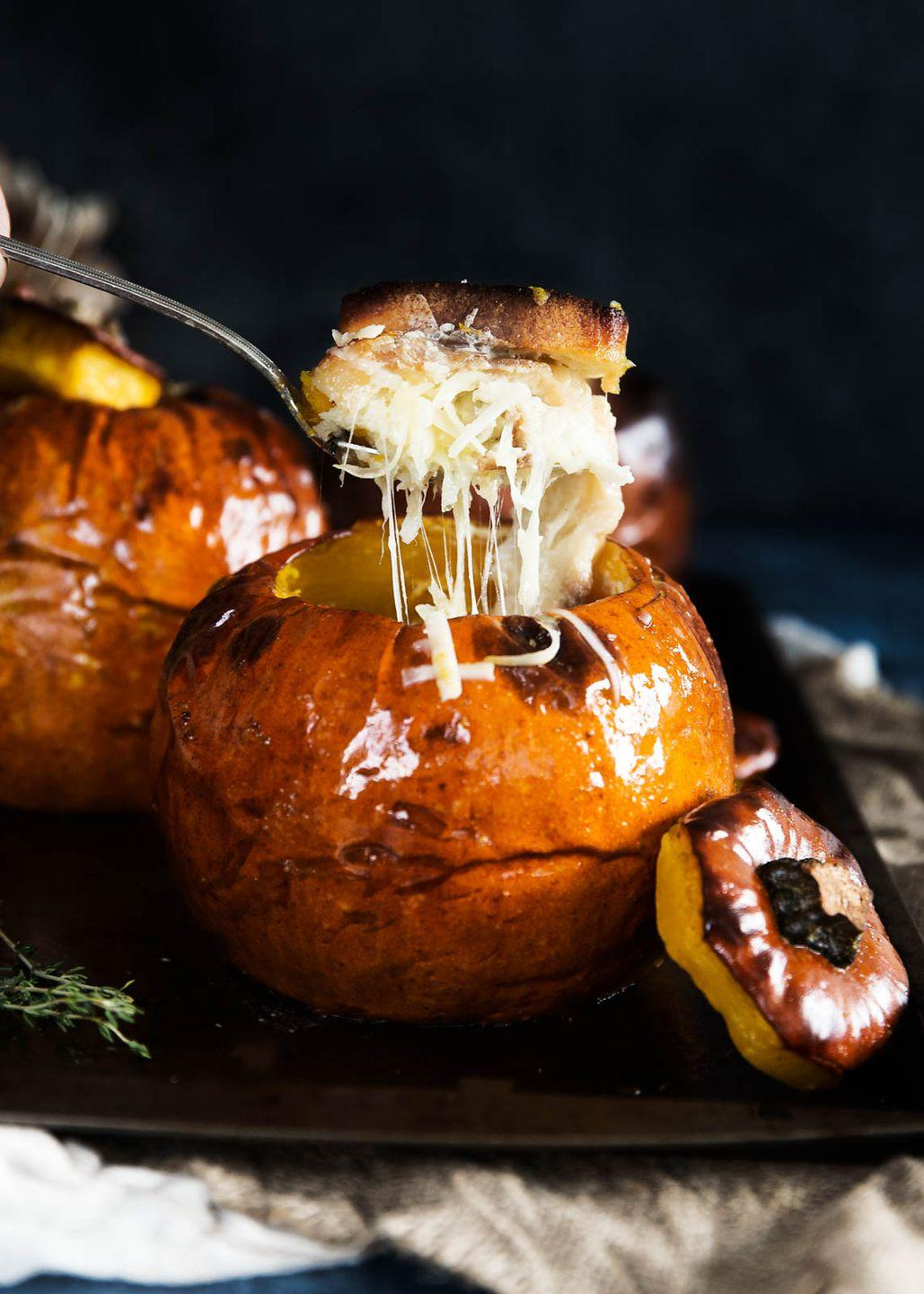 """<p>Cheese pull goals.</p><p>Get the recipe from <a href=""""http://bromabakery.com/2016/11/cheesy-bread-pudding-stuffed-pumpkin.html"""" rel=""""nofollow noopener"""" target=""""_blank"""" data-ylk=""""slk:Broma Bakery"""" class=""""link rapid-noclick-resp"""">Broma Bakery</a>.</p>"""