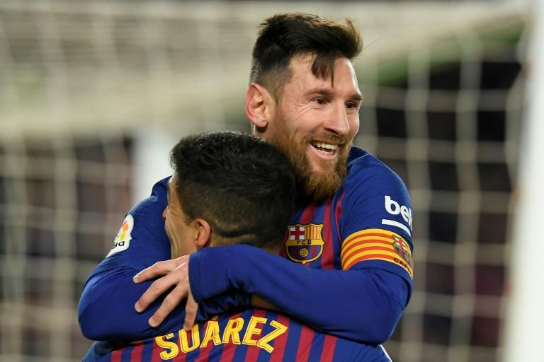 Team-mates: Lionel Messi made clear he did not want Barcelona to let Luis Suarez go