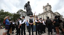 Striking image shows police forming ring around Churchill statue to stop clash between rival protesters