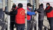 Community volunteers tie elderly man to tree after he breaks Covid-19 lockdown rules in northern China