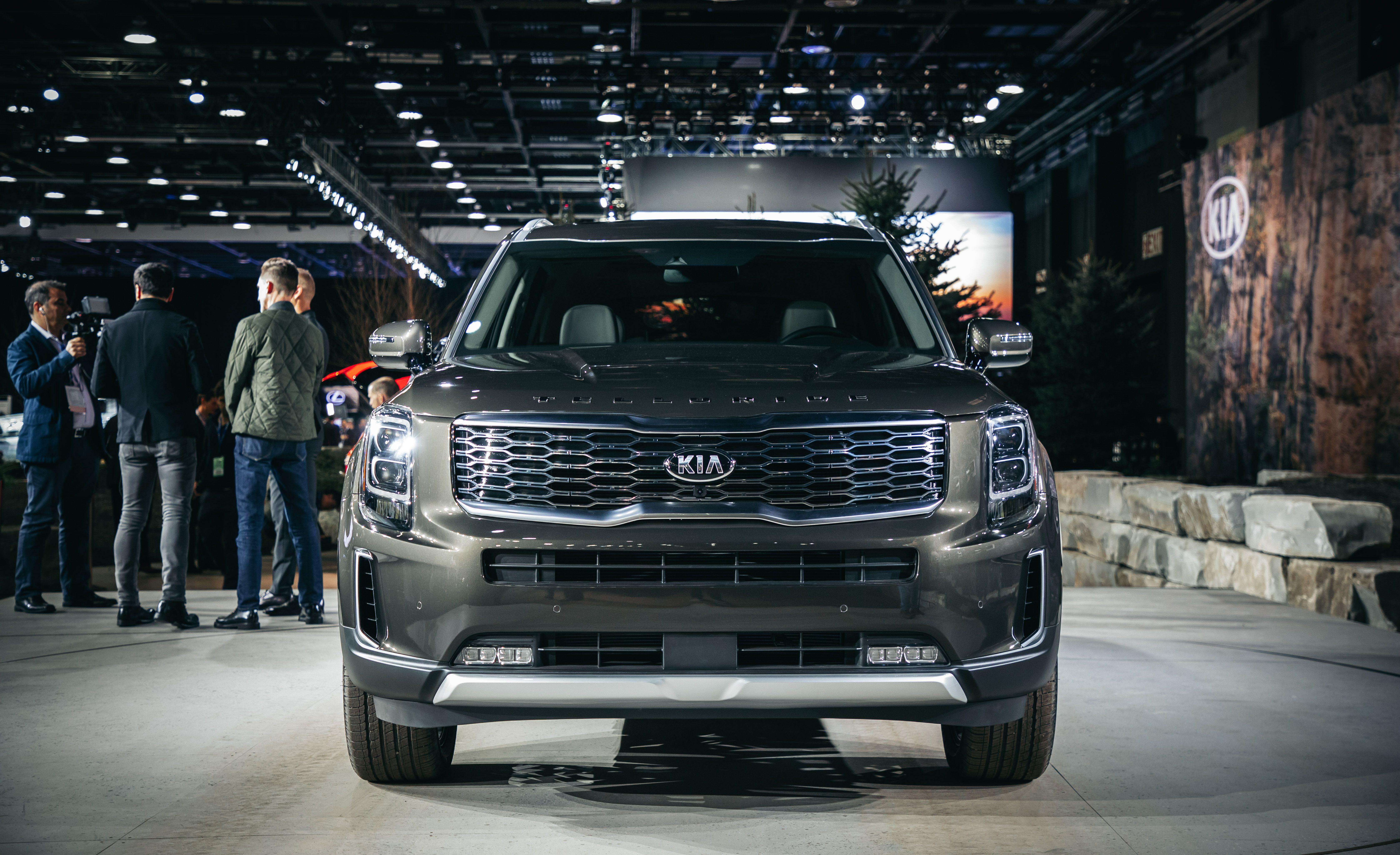 "<p>Kia already has a sizable three-row crossover geared toward American families-it's called <a href=""https://www.caranddriver.com/kia/sorento"" rel=""nofollow noopener"" target=""_blank"" data-ylk=""slk:the Sorento"" class=""link rapid-noclick-resp"">the Sorento</a>-but these days, an automaker can never have too many SUVs. Enter <a href=""https://www.caranddriver.com/news/a23031449/2020-kia-telluride-three-row-suv-photos-info/"" rel=""nofollow noopener"" target=""_blank"" data-ylk=""slk:the all-new, even bigger three-row Telluride"" class=""link rapid-noclick-resp"">the all-new, even bigger three-row Telluride</a>, which towers over the Sorento it joins in Kia's lineup. It's bolder, brasher, and more American-looking than anything Kia has ever made (the <a href=""https://www.caranddriver.com/reviews/a15147941/2009-kia-borrego-ex-short-take-road-test/"" rel=""nofollow noopener"" target=""_blank"" data-ylk=""slk:body-on-frame Borrego SUV"" class=""link rapid-noclick-resp"">body-on-frame Borrego SUV</a> included), and it debuted, fittingly, at <a href=""https://www.caranddriver.com/auto-shows/detroit-auto-show-news-reveals"" rel=""nofollow noopener"" target=""_blank"" data-ylk=""slk:the 2019 Detroit auto show"" class=""link rapid-noclick-resp"">the 2019 Detroit auto show</a> right in the American Big Three's back yard. At first blush, <a href=""https://www.caranddriver.com/kia/telluride"" rel=""nofollow noopener"" target=""_blank"" data-ylk=""slk:the Telluride"" class=""link rapid-noclick-resp"">the Telluride</a>'s look might look vaguely familiar (we initially likened it loosely to GMC's Yukon), but we had Kia's chief U.S. designer Tom Kearns walk us through the SUV's ""clean, pure, minimalistic"" style and the flourishes that help it stand apart. The man has led Kia's Irvine, California, design studio for 14 years-that's longer than half of Kia's existence in the American market-and is a big contributor to the brand's shedding of its bargain-basement image. </p>"