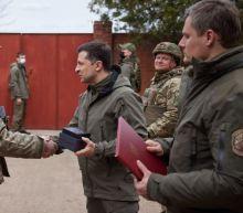 Russian troops mass near Ukraine's border, raising threat of wider war