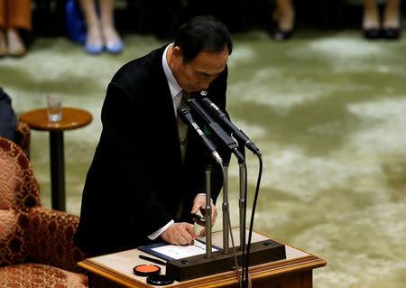 Yasunori Kagoike, head of Moritomo Gakuen, put his seal on a testimony during a parliamentary session in Tokyo, Japan March 23, 2017. REUTERS/Issei Kato