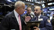 US stocks hold on to gains as dollar slides