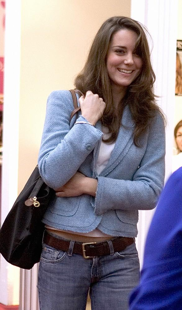 Kate and her mother, Carole Middleton, attended the Spirit of Christmas Shopping Festival in London, Kate wearing jeans and a light blue blazer.