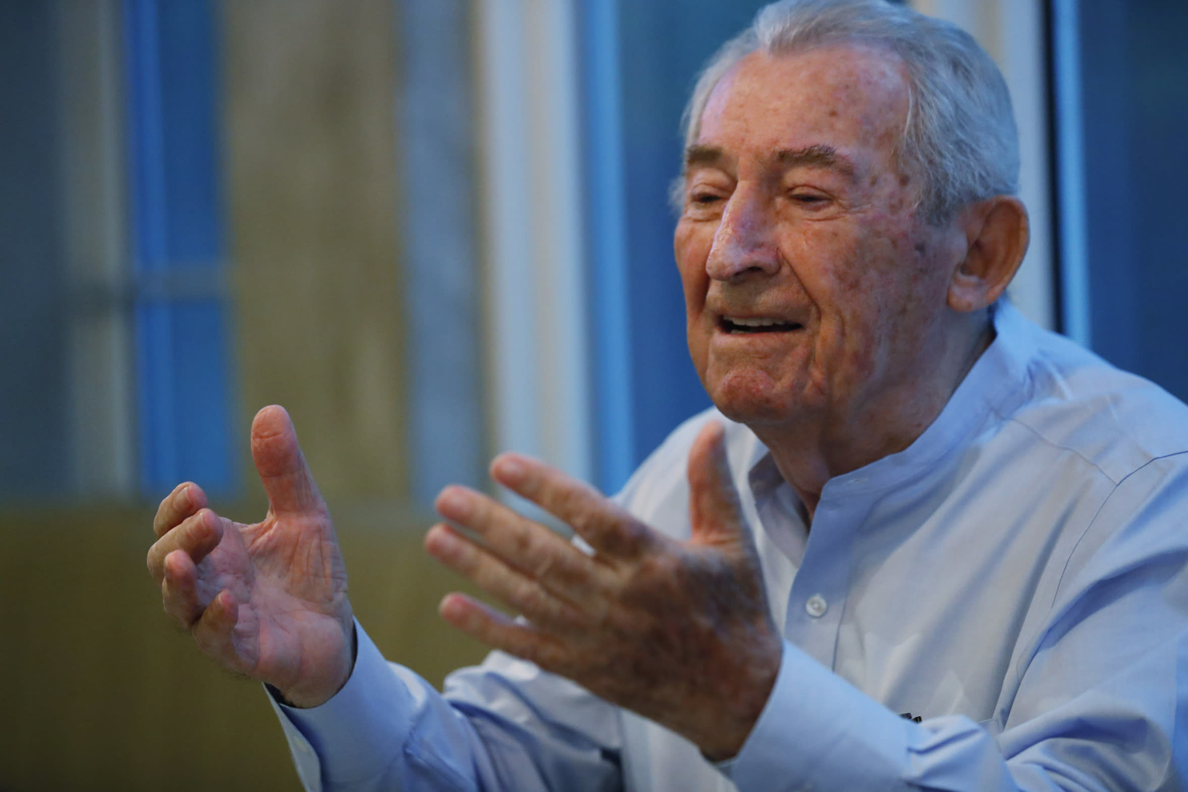 In this, Monday, Oct. 7, 2019 photo, David Schaecter, president of the Holocaust Survivors Foundation USA (HSF), gestures as he speaks during an interview with The Associated Press in Aventura, Fla. Aging Holocaust survivors are trying to recover insurance benefits that were never honored by Nazi-era companies, which could be worth billions of dollars. The companies have demanded original paperwork, such as death certificates, that were not available after World War II. The survivors want to take insurance companies to court in the U.S. to recover the money, but it would take an act of Congress to allow it. (AP Photo/Wilfredo Lee)