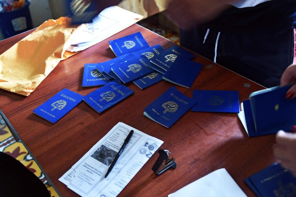 Cuban passports are seen on May 15, 2015 at the immigration office in Puerto Obaldia, 300 km southeast of Panama City