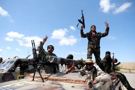 FILE PHOTO: Libyan National Army (LNA) members head out of Benghazi to reinforce troops advancing towards Tripoli