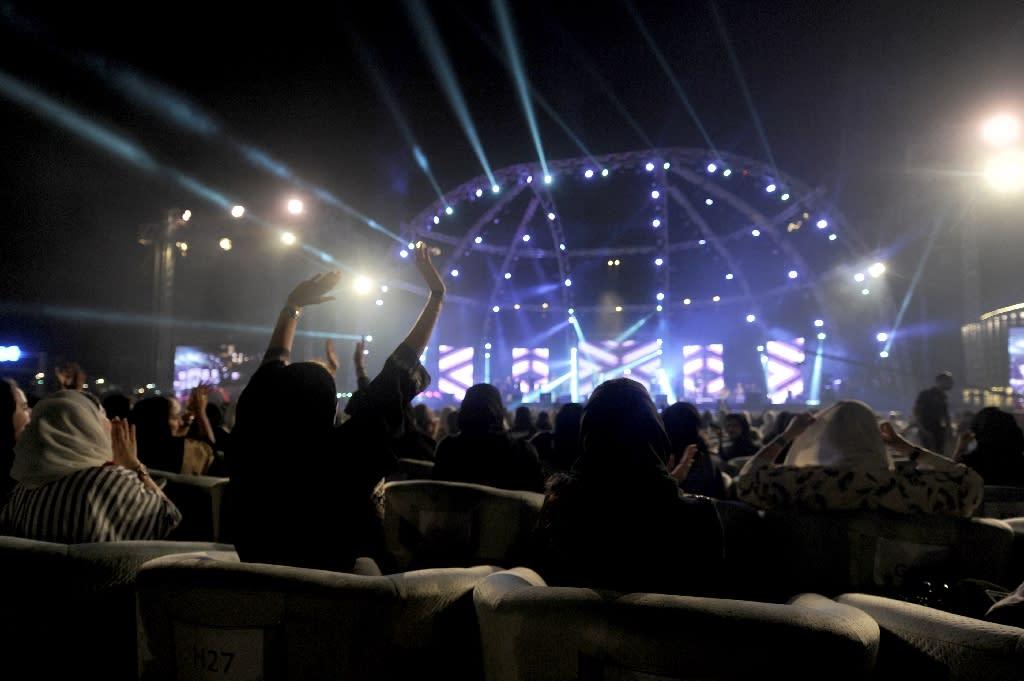 Saudi women attend a concert by Egyptian pop sensation Tamer Hosny in the western city of Jeddah (AFP Photo/Amer HILABI)