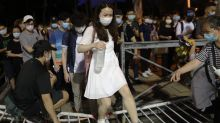 Hong Kong: Tens of thousands defy ban to attend Tiananmen vigil