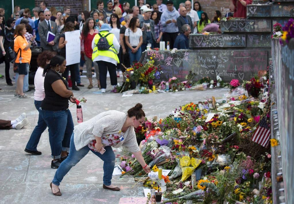 People leave flowers at an impromptu memorial in Portland, Oregon, on June 1, 2017