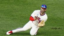 Harper back in lineup as Phillies DH after back stiffness