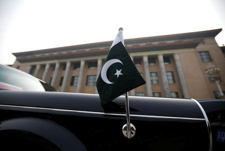 A car with a Pakistani flag waits for Pakistani Minister Imran Khan during his visit in Beijing