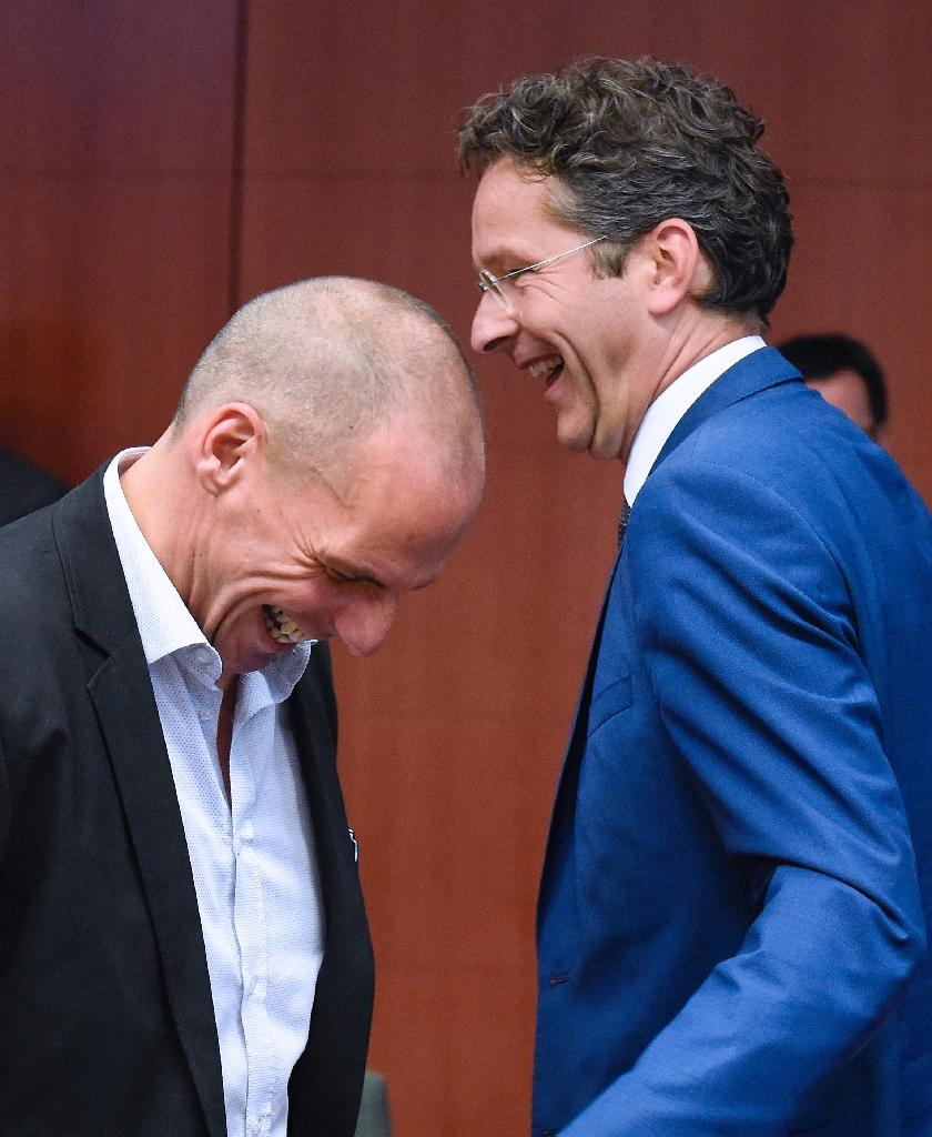 Eurogroup chief Jeroen Dijsselbloem and Greece's Yanis Varoufakis sharing a lighter moment in 2015, but the relationship between them wasn't easy had before an Eurogroup Council meeting on May 11, 2015 at EU Headquarters in Brussels. AFP PHOTO/JOHN THYSGreek Finance Minister Yanis Varoufakis (L) jokes with Dutch Finance Minister and president of Eurogroup Jeroen Dijsselbloem before an Eurogroup Council meeting on May 11, 2015 at EU Headquarters in Brussels. AFP PHOTO/JOHN THYS (AFP Photo/JOHN THYS)