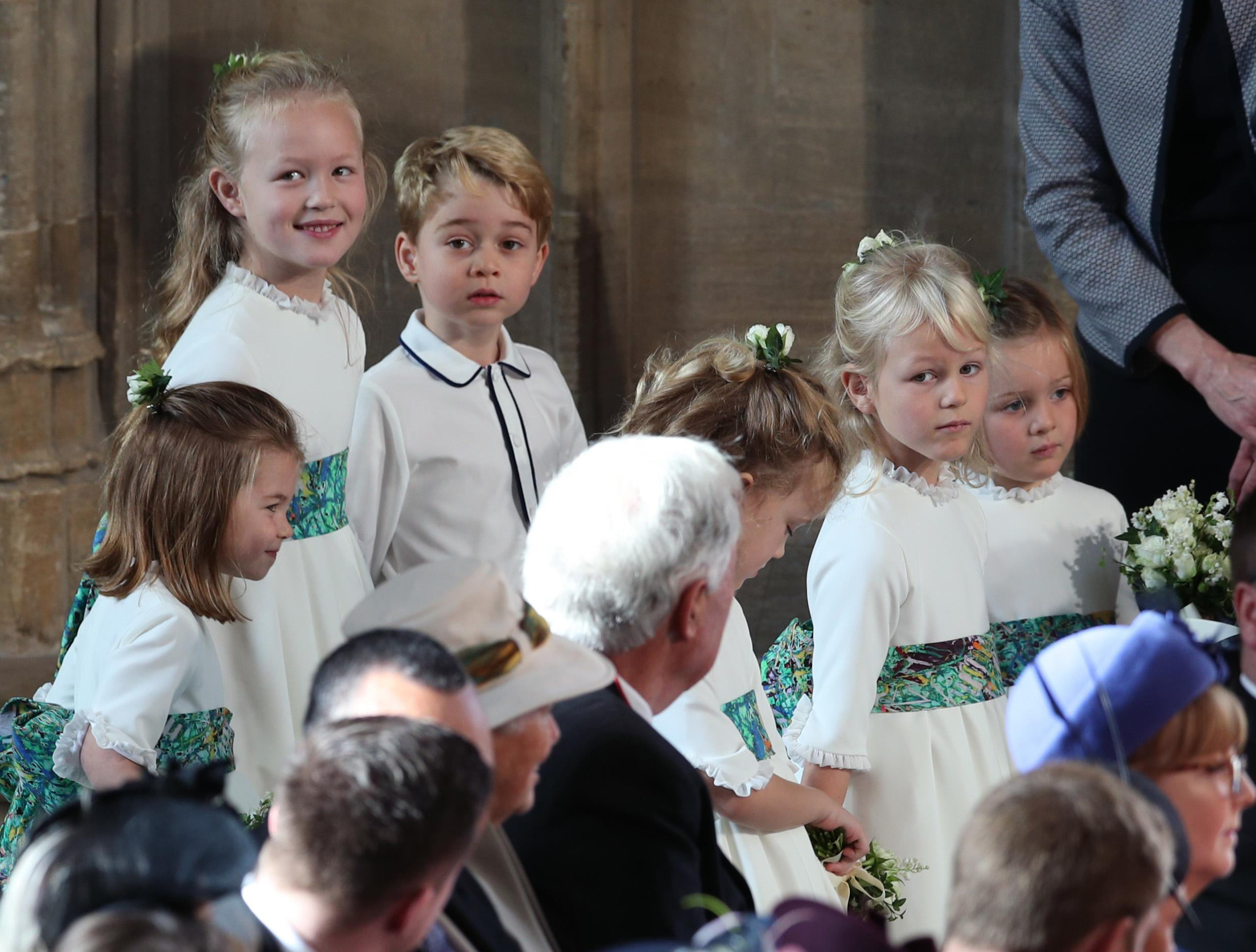 The bridesmaids and page boys, including Savannah Phillips (top), Prince George and Princess Charlotte (bottom left), arrive for the wedding of Princess Eugenie to Jack Brooksbank at St George's Chapel in Windsor Castle. PRESS ASSOCIATION Photo. Picture date: Friday October 12, 2018. Photo credit should read: Yui Mok/PA Wire