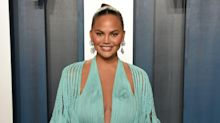 Chrissy Teigen explains why she's taken a pregnancy test every month since the age of 21