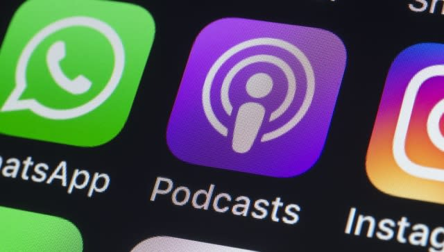 London, UK - July 24, 2018: The buttons of Podcasts, WhatsApp, Instagram, Pinterest, Twitter, Snapchat and other apps on the screen of an iPhone.