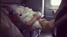 Photo of elderly couple holding hands during Hurricane Florence nursing home evacuation warms hearts