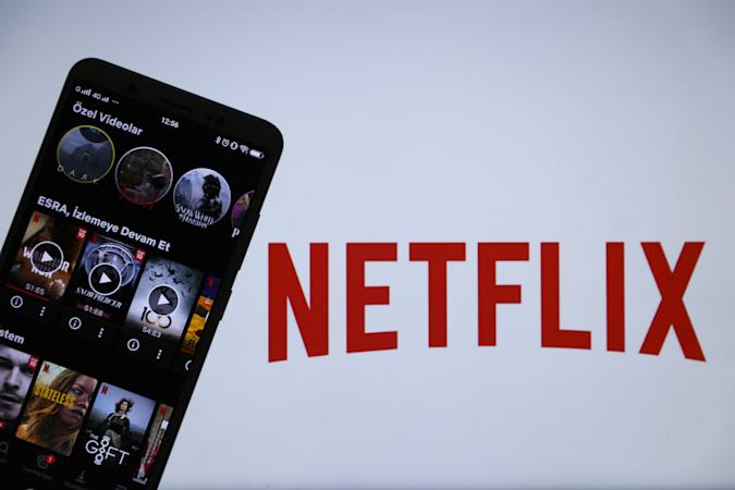 ANKARA, TURKEY - JULY 13: In this photo illustration, the logo of Netflix is displayed on a laptop screen and the application is displayed on a smart phone screen in Ankara, Turkey on July 13, 2020. (Photo by Esra Hacioglu/Anadolu Agency via Getty Images)