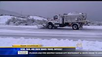 Wind, rain and snow makes travel difficult